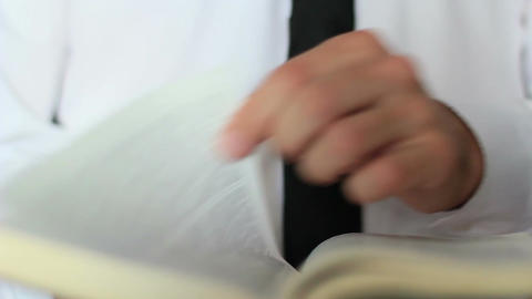 Businessman Leafing Through Book Footage