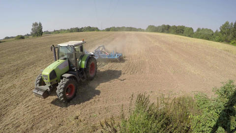 Tractor sowing in soil on sunny day, time lapse 4K Footage