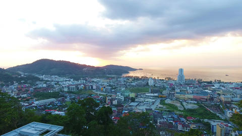 Aerial, 4K Landscape View of Patong Town In Phuket South of Thailand at sunset Footage