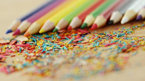 Colored pencils arranged in diagonal line with pencil shavings Footage