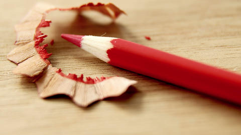 Close-up of red color pencil with pencil shaving Footage