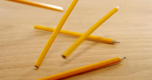 Yellow colored pencils on wooden table Footage