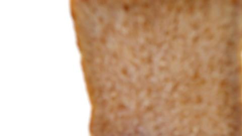Single bread slice on white background Footage