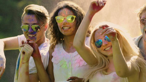 Excited friends celebrating summer vibrant Color festival, extra-slow motion Footage