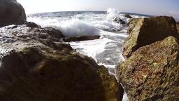 Waves over wavebreaker Footage