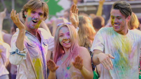 Funny excited youngsters actively dancing at Color festival, extra-slow motion Footage
