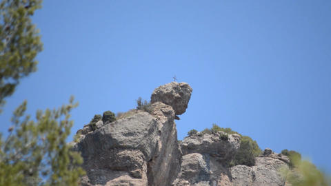Cross On Top Of Scary Rock Footage