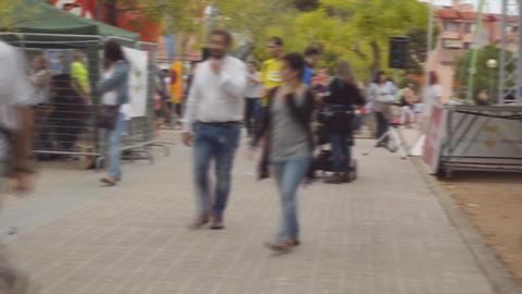 Crowded Event On A Sidewalk Footage