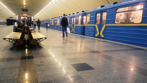 Metro train leaving subway station, passengers walking platform, urban transport Footage