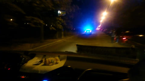 Police car rushing to emergency call, pursuit of criminal in night city street Live Action