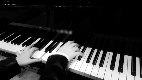 Female pianist hands pressing ivory keys, playing nice piano music at concert Footage