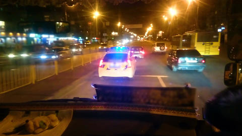 Police patrol car driving night city street, law enforcers on duty, public order Footage