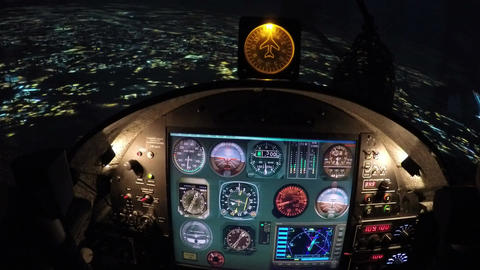Simulator of night flight above city, training equipment for beginner pilots Footage