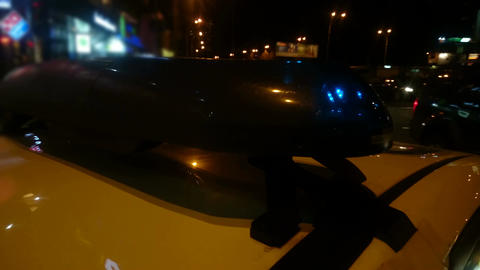Closeup of lightbar on police car cabin flashing at night, law enforcers on duty Footage