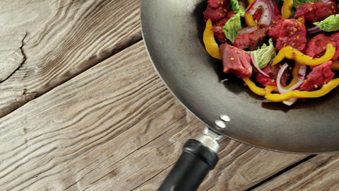 Raw meat pieces marinated with herbs and yellow pepper Live Action