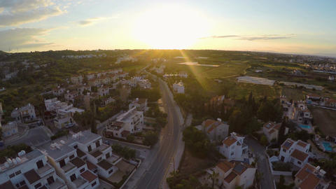 Comfortable apartment buildings for tourists in Cyprus resort, sunset on horizon Footage