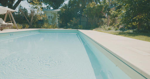 Tracking shot of a large backyard with a swimming pool in a luxurious house Footage