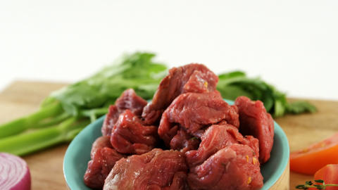 Marinated meat pieces and ingredients Live Action