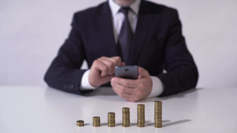 Man using mobile app, calculating income from deposit or successful investment Footage