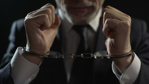 Angry criminal imprisoned in handcuffs, unfair businessman punished for offense Footage