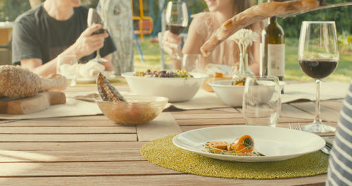 People eating lunch and drinking wine at the porch outdoors Footage