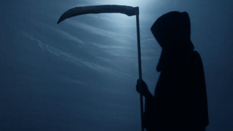 Terrible shadow of Grim Reaper with scythe turning to camera, risk of death Footage