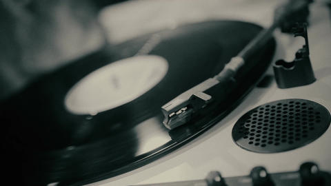 Retro vinyl spinning on turntable, disclosure of secret archival record, closeup Live Action