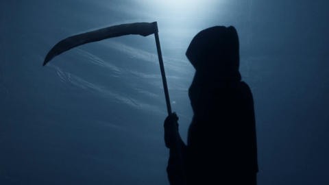 Death silhouette came to take terminally ill person, creepy Grim Reaper shadow Live Action