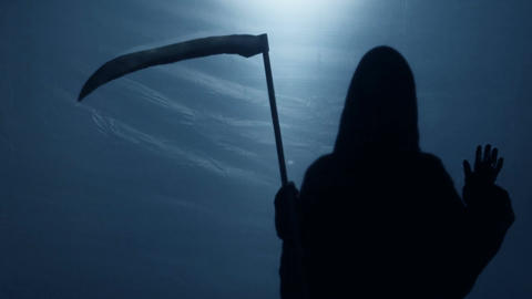 Inevitable Grim Reaper shadow looking at sinner from underworld, death anxiety Live Action