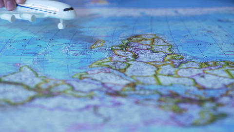 Aircraft model flying over world map, passenger transportation services, airline Footage