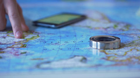 Man studying Africa continent on map, choosing travel destination for vacation Footage