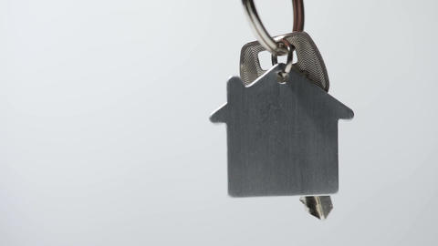 Successful owner of real estate holding key from house, mortgage loan, lottery Footage