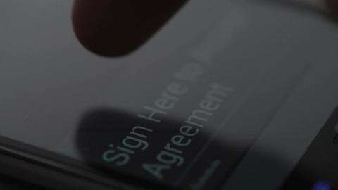 Person putting signature on modern gadget touchscreen closeup, authorization Live Action