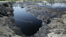 Former dump toxic waste, oil lagoon contamination water and soil pollution Footage