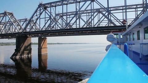 Passenger ship passes under the railway bridge Footage