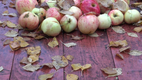 Leaves and apples on table in the autumn Footage