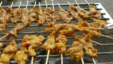 4K footage Street food, Pork or Chicken Satay or Sate grilling on the satay char