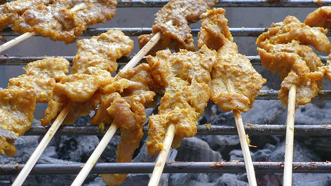 4K footage Street food, Pork or Chicken Satay or Sate grilling on the satay char Footage