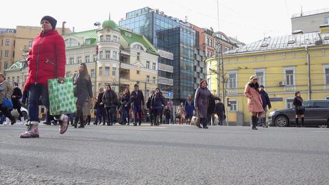 People Walking Over Crosswalk Footage
