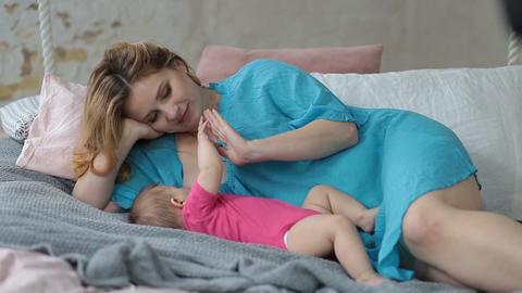 Affectionate mother breastfeeding her baby girl ビデオ