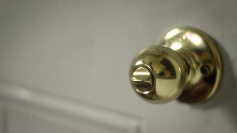 Multipurpose clip - Man locks and unlocks his doorknob basic lock Footage