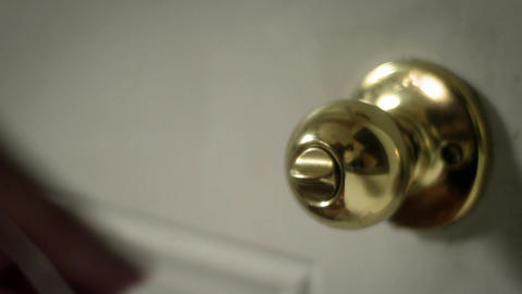 Man opens doorknob and leaves house during the day Footage