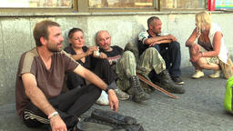 Authentic man and women homeless in city kissing, group Footage