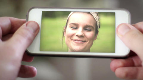 Video chatting with young attractive blonde brunette over smartphone Footage