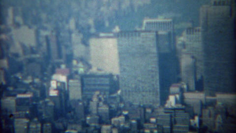 1968: Dirty city skyline with Americana building sign featured Footage