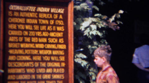 1966: Boy pretends to learn about Oconaluftee Indian Village Footage