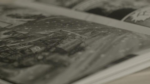 Close Up Of Rotating Comic Book Pages stock footage