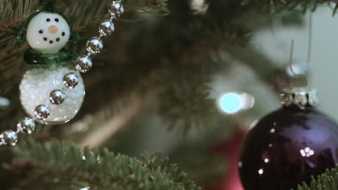 Focus on a Snowman figure in a Christmas Tree Footage