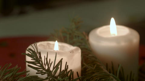 Two white candles in a traditional German Christmas decoration Footage
