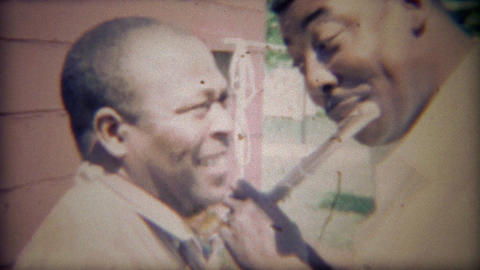 1967:African American man plays flute for best friend, comedy ensues Footage